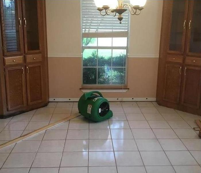 One of our air movers drying the floor of this home after flood damage struck