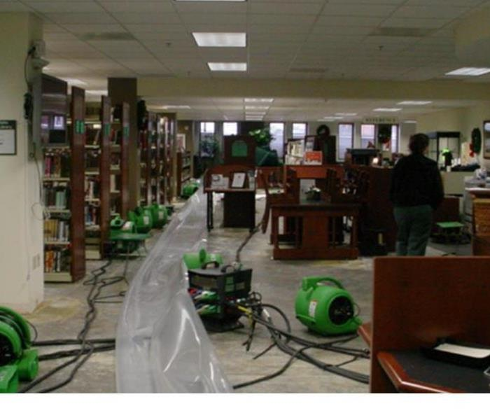 flooded library with green air movers in place