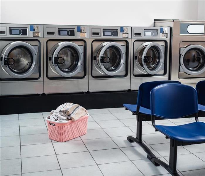 Row of washing machines in a neat and clean laundromat